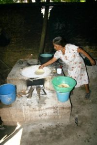 Woman makes tortillas