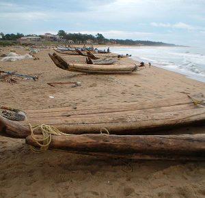kattumaran boats on the beach