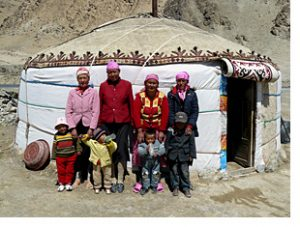 Family at yurt by lake karakul china