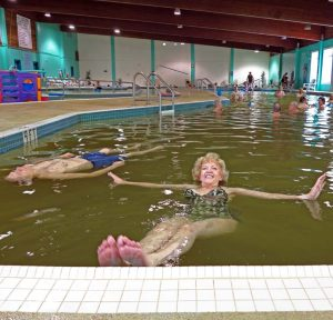 The author floating in Manitou springs resort pool